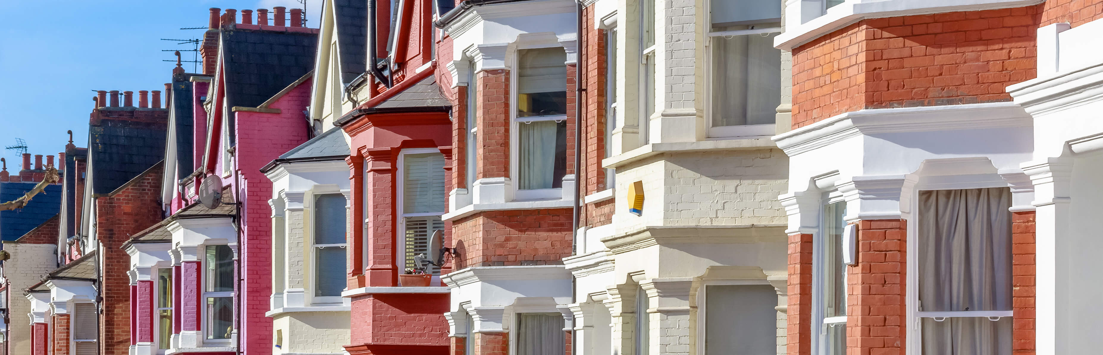domestic residence planning advice image of brightly coloured houses side by side